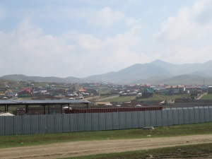 "The outskirts of UB. The sprawl in the valley is largely made up of gers - with little or no access to electricity, running water, or plumbing. Each year more and more nomads settle in these ""ger districts"" which are plagued by many obvious health and sanitation issues."