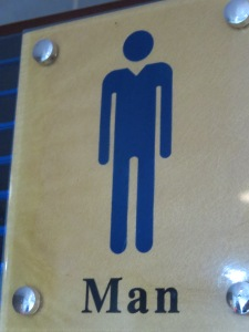 "This bathroom is for ""man"" only, and apparently that means you have to wear a v-neck too."