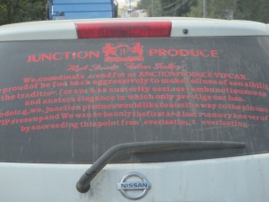 English gibberish on the back of a business vehicle.