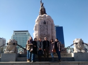 Posing in front of the giant statue of General Sukhbaatar, a  Mongolian hero of the revolution.