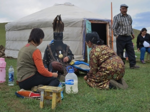 A woman talks to one of her ancestral spirits which has taken over the body of the shaman.