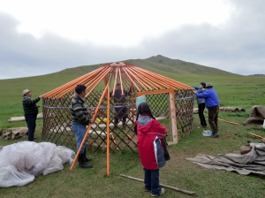 The family works with incredible efficiency to take down the ger erected earlier that day for the ceremony.