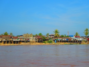 Houses on stilts line the water. In some areas the water level can increase by 2-4 meters along the shore.