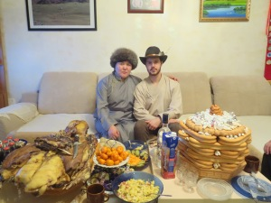 My supervisor and I with the traditional feast set before us! In front you can see the sweet curd dish with raisins along with an array of fruits, small vegetable salads, and juice. The levels of biscuits in the towers displayed at one's household indicate the eldest host's social status. (The highest number 9 is reserved for the President, 7 for eldest grandparents, 5 for younger grandparents, etc.)