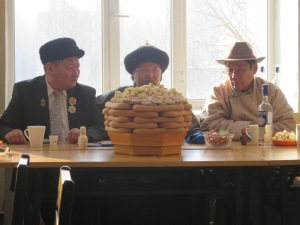 "While Tsagaan Sar is officially only three days (up from two last year) the first day back to work in the city also generally consists of Tsagaan Sar festivities. Here school officials await the Tsagaan Sar Greeting Ceremony with a tower of biscuits and ""airal"" in front of them."