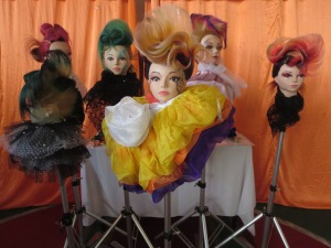 The products of the creative hair dummy contest on display.