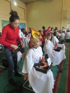 Creative hair design competition between second-year diploma students. The stylist in red won an international competition last year.