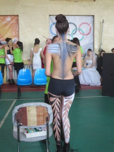 Shockingly, fifteen year old students pose completely topless for the body painting competition!