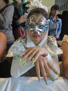 Models wore full costumes to highlight their nails!