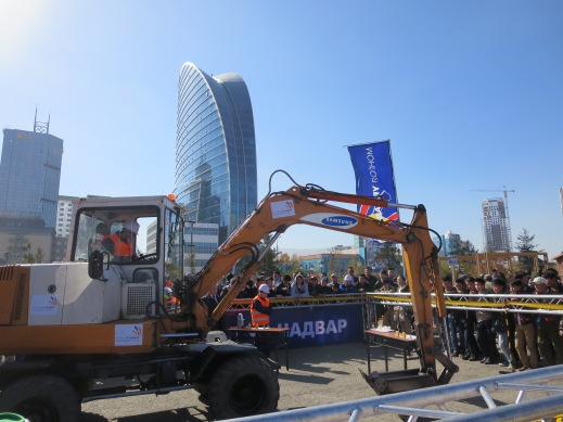 A construction school's demonstration at the National Expo in Chinggis Square, the national mall.