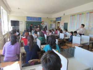 The class watches students give a presentation in my English club.