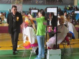 Judges inspect the students' creative hair creations!