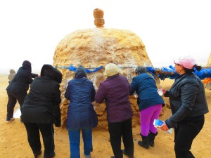 A famous shrine, specifically for women hoping to become or already pregnant, this double stupa is intentionally shaped liked gigantic breasts. Women make offerings of milk in the windy morning.
