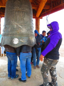 The best spot for the energy is inside the bell. At first I thought these men were just messing around, but it's a ritual!