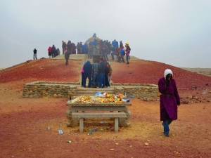 The central shrine, around which Mongolians sing a sacred incantation carved into a monument and make offerings of vodka, candy, and milk.