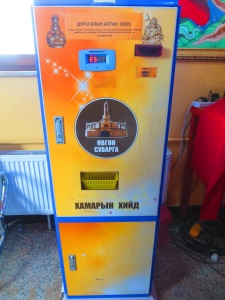 A stupa coin vending machine! What?! For a mere 5,000 tugriks your donation can yield a miraculous collector's item! (Unless the machine eats your money and a monk needs to unplug and re-plug it in for you first...)