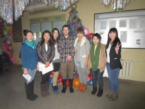 "Students and I pose in front of a tinseled-out ""New Year's Tree!"""