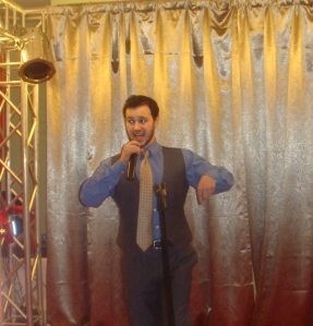 A coworker's photo of me in (or out) of my element, singing at the New Year's party in front of hundreds of people on two days notice!
