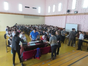 Getting set up to lecture about American colleges and universities to a students audience in Sukhbaatar, Selenge.